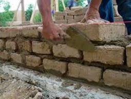 Laying adobe bricks