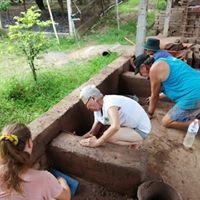 Laying and leveling adobe bricks