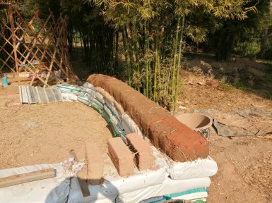 Gravel bags foundation, earth bags and cob, ready for the adobe bricks