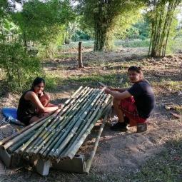 Attaching treated bamboo to make the yurt walls